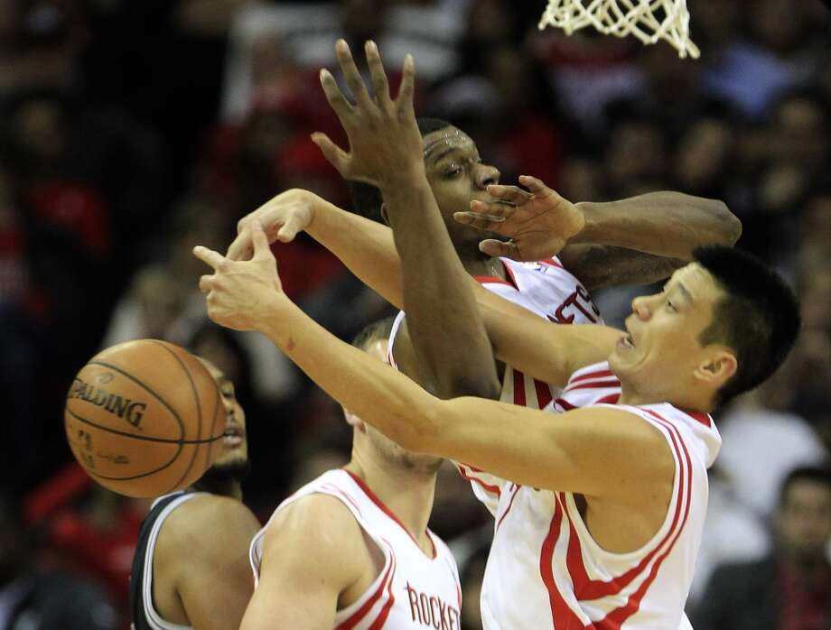 Jeremy Lin and Terrence Jones of the Rockets get tangled up fighting for a rebound. Photo: Karen Warren, Houston Chronicle