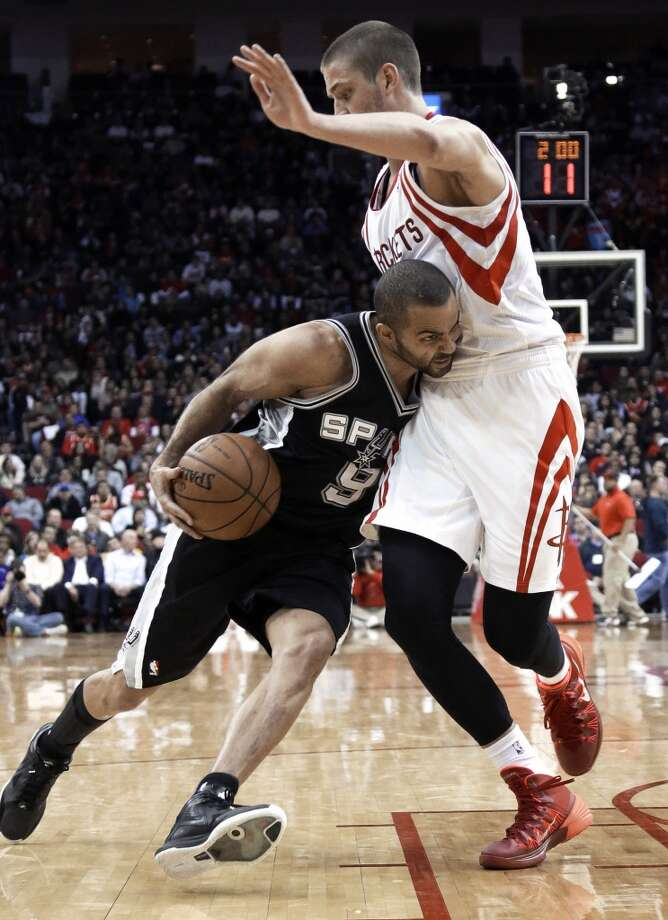 San Antonio Spurs' Tony Parker (9) pushes against Houston Rockets' Chandler Parsons (25) during the second half of an NBA basketball game Tuesday, Jan. 28, 2014, in Houston. The Rockets won 97-90. (AP Photo/Pat Sullivan) Photo: Associated Press
