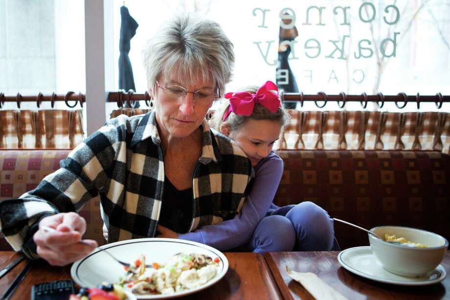 Daneil Reed has the unusual opportunity to share lunch with her daughter Jordan Reed, 6, in downtown Houston during a school day. Photo: Marie D. De Jeséºs, Staff / © 2014 Houston Chronicle