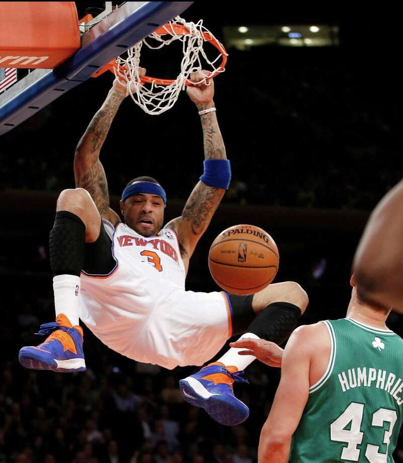 New York Knicks forward Kenyon Martin (3) dunks in front of Boston Celtics center Kris Humphries (43) in the first half of an NBA basketball game at Madison Square Garden in New York, Tuesday, Jan. 28, 2014. (AP Photo/Kathy Willens) ORG XMIT: MSG104 Photo: Kathy Willens / AP