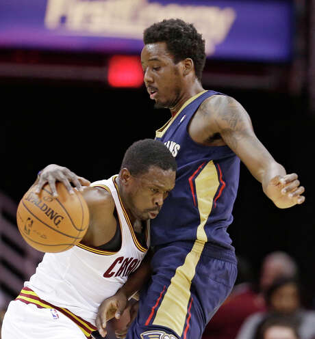 The Cavaliers' Luol Deng, left, finds little room to operate against the Pelicans' Al-Farouq Aminu. Photo: Tony Dejak, STF / AP