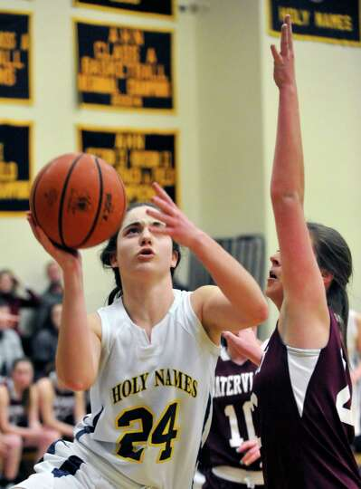 Academy of the Holy Names' Courtney Kramer (24) shoots against Watervliet during their girls bask
