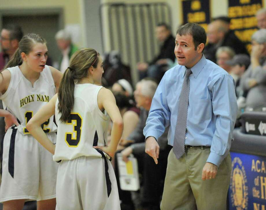 Academy of the Holy Names head coach Steven Gigliello coachs his team against Watervliet during their girls basketballl game in Albany, N.Y., Tuesday, Jan. 28, 2014. (Hans Pennink / Special to the Times Union) ORG XMIT: HP102 Photo: Hans Pennink / Hans Pennink