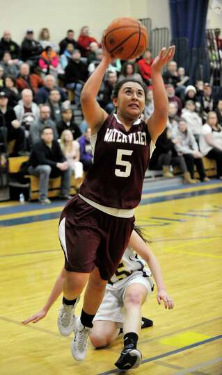 Watervliet's Kaylee Maldonado (5) puts up a shot against Academy of the Holy Names during their girl