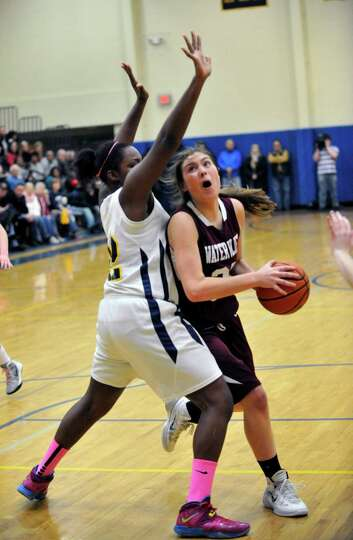 Academy of the Holy Names' Deja Deas ,left, defends against Watervliet's Teagan Clough during their