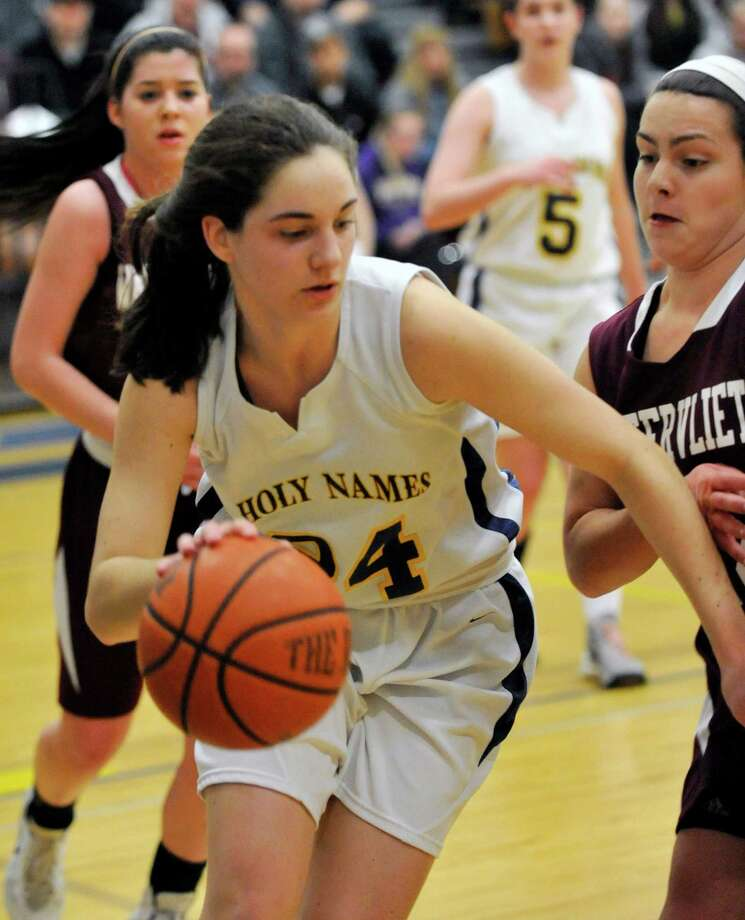 Academy of the Holy Names' Courtney Kramer ,left, moves the ball against Watervliet during their girls basketballl game in Albany, N.Y., Tuesday, Jan. 28, 2014. (Hans Pennink / Special to the Times Union) ORG XMIT: HP112 Photo: Hans Pennink / Hans Pennink