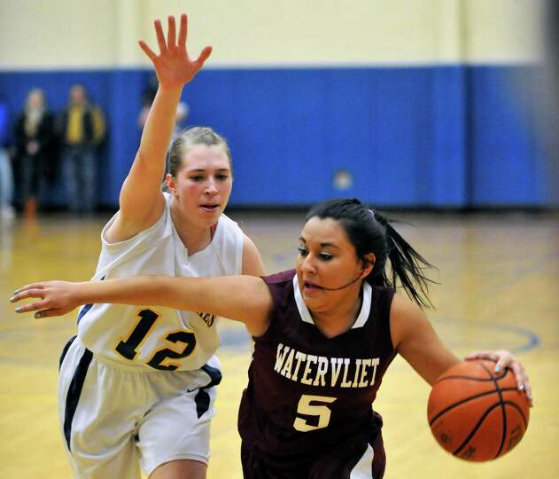 Academy of the Holy Names' Rhianna Franchini (12) defends against Watervliet's Kaylee Maldonado (5)