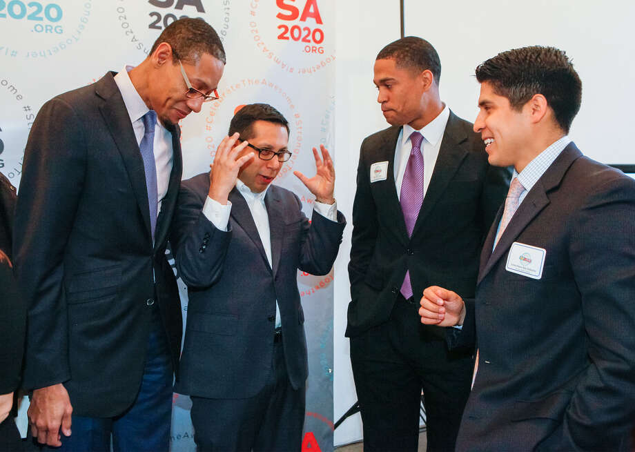 "SA2020 CEO Darryl Byrd (from left), Councilman Diego Bernal, athlete Brandon Logan and Councilman Rey Saldana visit during SA2020's ""resolutions"" news conference. Photo: Photos By Marvin Pfeiffer / San Antonio Express-News / Express-News 2013"