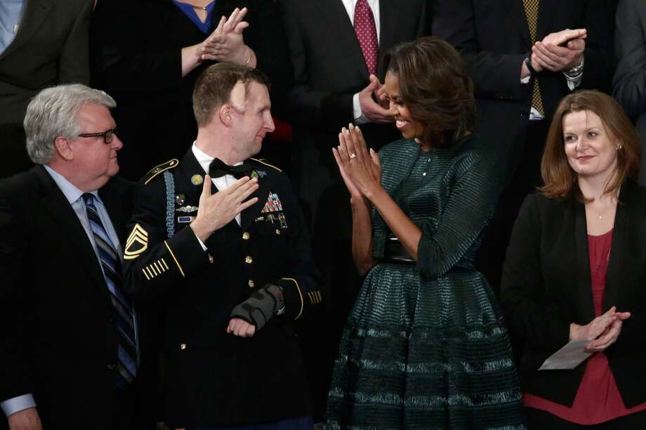 First lady Michelle Obama with one of her guests, U.S. Army Ranger Sgt. First Class Cory Remsburg, who was wounded in Afghanistan. (Win McNamee/Getty)