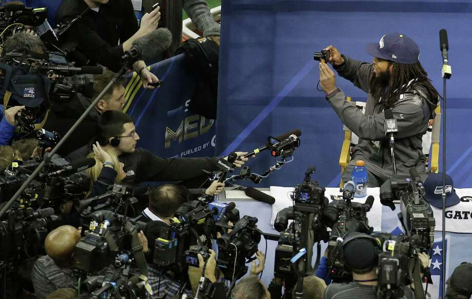 "Richard Sherman, taking pictures at media day, has become a household name since his televised outburst following the NFC title game. ""There's more to me than that rant,"" he said. Photo: Charlie Riedel / Associated Press / AP"