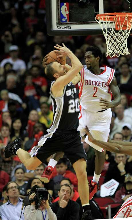 Spurs guard Manu Ginobili, left, and Rockets guard Pat Beverley battle for the upper hand during close-quarter action in the second half Tuesday night at Toyota Center. Photo: Karen Warren, Staff / © 2013 Houston Chronicle