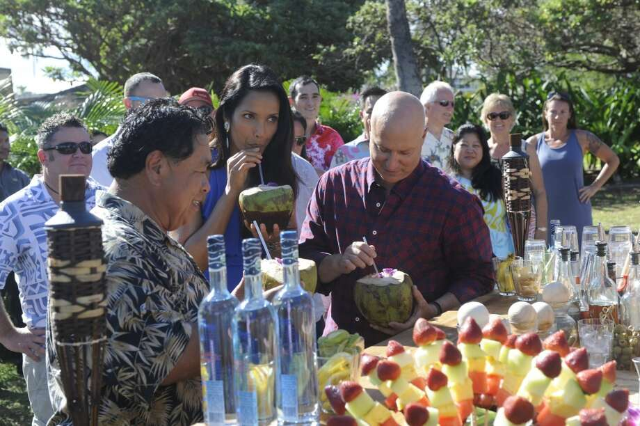 "They've got a lovely bunch of coconuts: Sam Choy (left),    Padma Lakshmi  and Tom Colicchio taste the wares at a special reception for ""Top Chef"" contestants on the lawn at the Andaz Maui at Wailea. Photo: David Moir, Bravo"