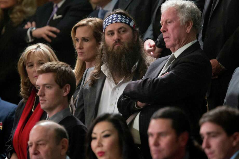 "Willie Robertson, star of A&E's ""Duck Dynasty"" show, center, waits to listen to President Barack Obama deliver the State of the Union address to a joint session of Congress at the Capitol in Washington, D.C. on Tuesday, Jan. 28, 2014.  Photo: Andrew Harrer, Bloomberg / © 2014  Bloomberg Finance LP"