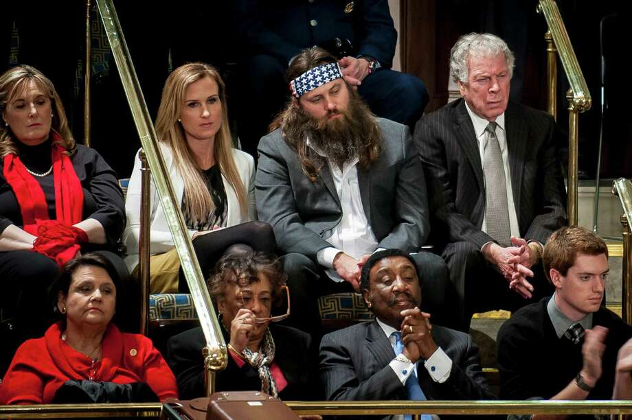 "Willie Robertson, top row second right, of ""Duck Dynasty"", looks on as U.S. President Barack Obama delivers the State of the Union address to a joint session of Congress at the Capitol on Tuesday, Jan. 28, 2014.  Photo: Pete Marovich, Bloomberg / © 2014  Bloomberg Finance LP"
