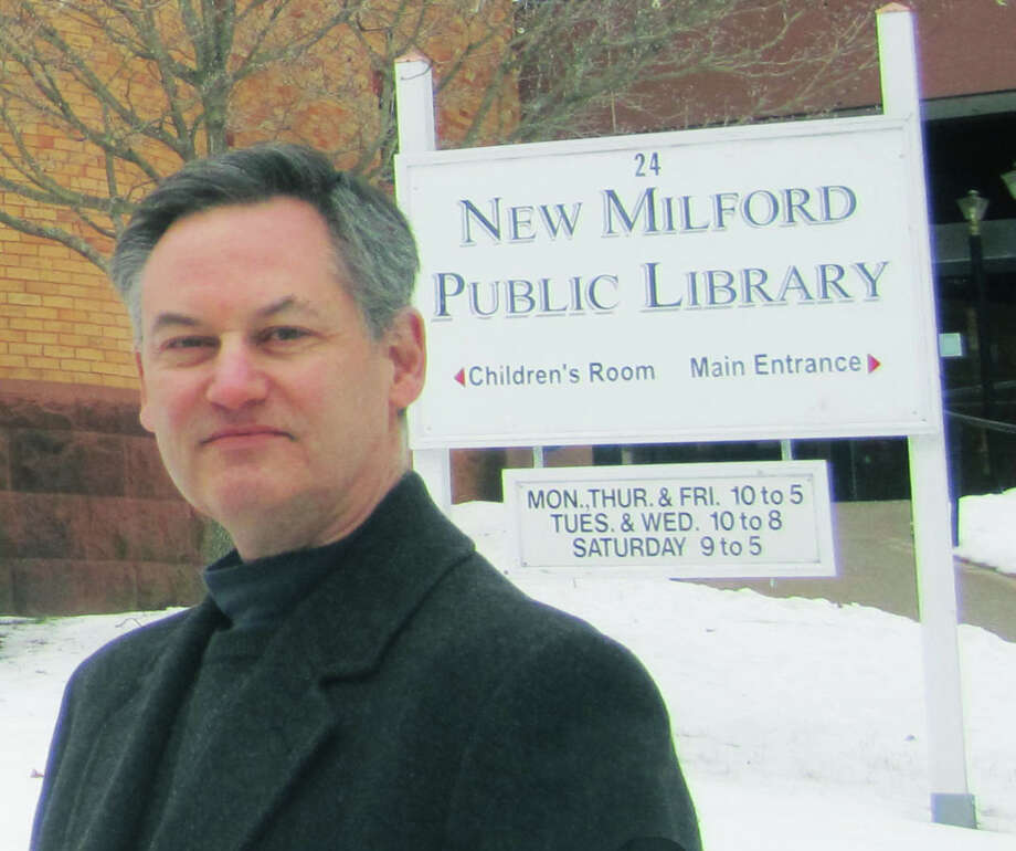 Carl DeMilia will be stepping down from his role as executive director at New Milford Public Library Feb. 28, 2014. Photo: Norm Cummings / The News-Times