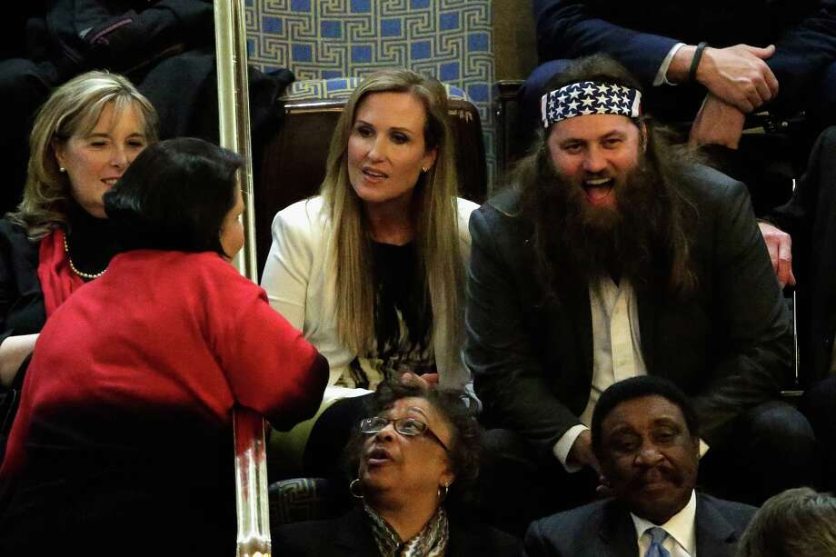 Willie Robertson, right, of the television show Duck Dynasty and his wife Korie Robertson, center, wait for U.S. President Barack Obama to deliver the State of the Union address to a joint session of Congress in the House Chamber at the U.S. Capitol on Jan. 28, 2014.  Photo: Win McNamee, Getty Images / 2014 Getty Images