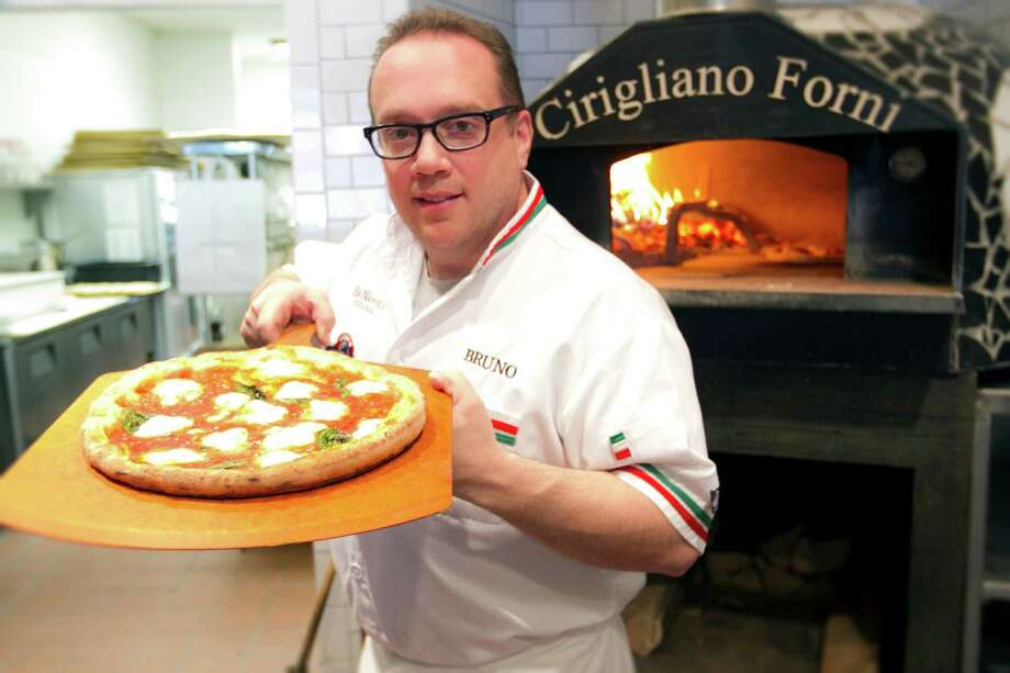 "Bruno DiFabio, owner of Pinnochio Pizza in New Canaan, will appear as a judge on the Food Network show ""Chopped"" Sunday, Feb. 2. Photo: Contributed Photo, Contributed / New Canaan News Contributed"