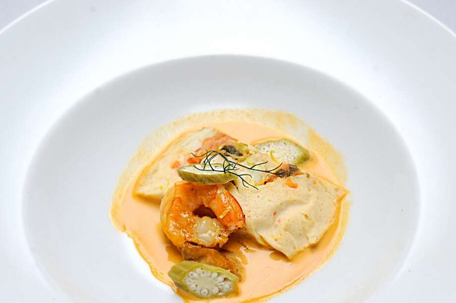 Carlos: Steamed Seafood Tamal with Saffron Cream Sauce and Pickled Okra