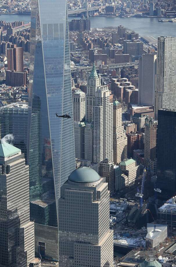 """A Blackhawk helicopter flown by U.S. Customs and Border Protection (CBP), flies past the One World Trade Center on January 28, 2014 in New York City. The CBP aircraft flown by """"air interdiction agents"""" from the CBP's Office of Air and Marine (OAM), are providing air support for Super Bowl XLVIII this Sunday. Photo: John Moore, Getty Images"""
