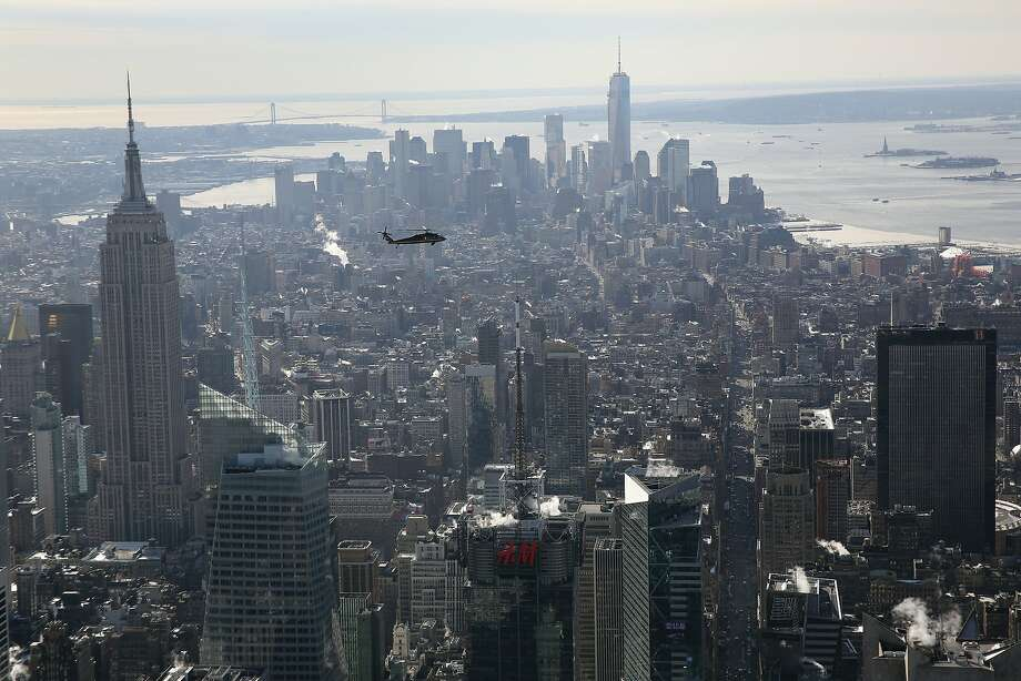 "A Blackhawk helicopter flown by U.S. Customs and Border Protection (CBP), flies over Midtown Mahnattan in route to MetLife Stadium on January 28, 2014 in New York City. Helicopters piloted by ""air interdiction agents"" from the CBP's Office of Air and Marine (OAM), are providing air support for Super Bowl XLVIII this Sunday at MetLife Stadium. Photo: John Moore, Getty Images"