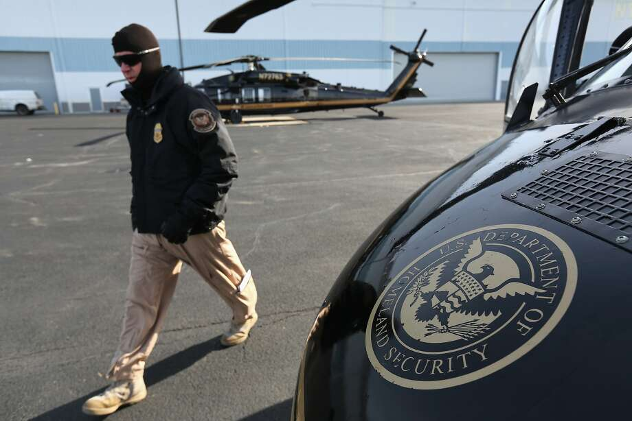 "An ""air interdiction agent"" prepares to fly a U.S. Customs and Border Protection (CBP), Blackhawk helicopter to MetLife Stadium on January 28, 2014 in Long Island, New York. Helicopters piloted by agents from the CBP's Office of Air and Marine (OAM), are providing air support for Super Bowl XLVIII this Sunday. Photo: John Moore, Getty Images"