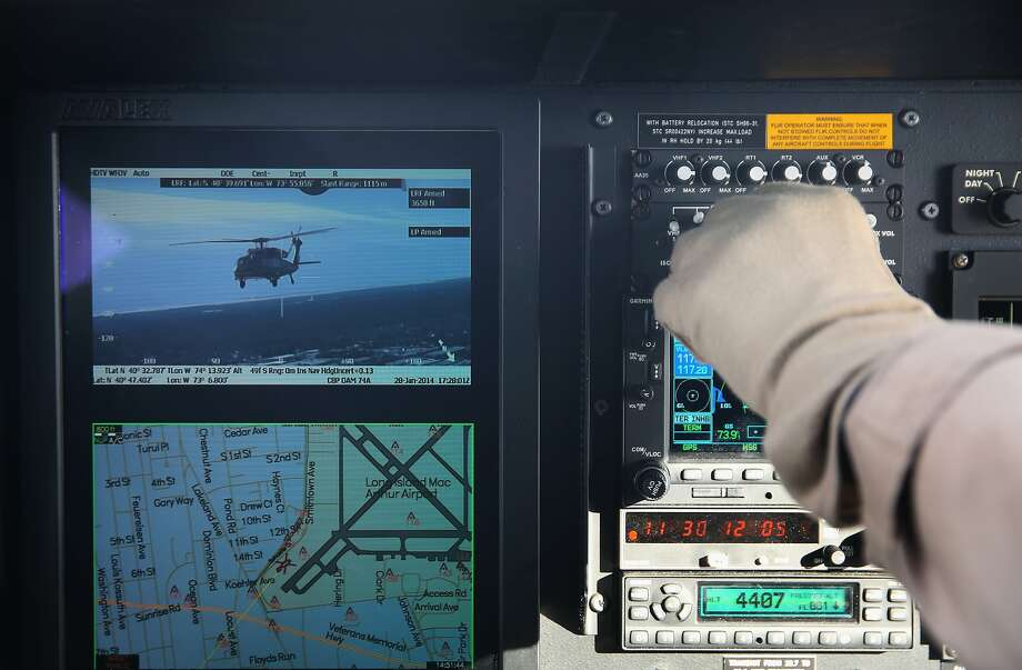 A Customs and Border Protection helicopter videos another CBP helicopter as the pair flies near MetLife Stadium ahead of Super Bowl XLVIII. Photo: John Moore, Getty Images