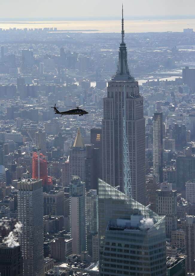 A Blackhawk helicopter flown by U.S. Customs and Border Protection flies past the Empire State Building in route to MetLife Stadium on January 28, 2014 in New York City. Photo: John Moore, Getty Images