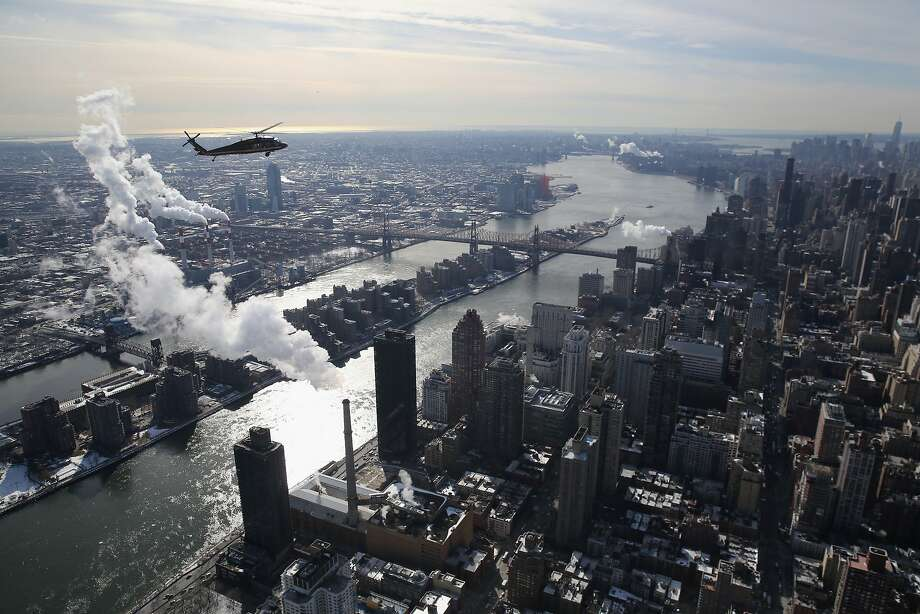 A Blackhawk helicopter flown by U.S. Customs and Border Protection flies over the East River and Manhattan in route to the Metlife Stadium. Photo: John Moore, Getty Images