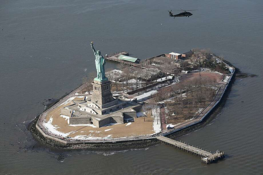 "A Blackhawk helicopter flown by U.S. Customs and Border Protection (CBP), flies past the Statue of Liberty while paroling near MetLife Stadium on January 28, 2014 in New York City. The CBP aircraft flown by ""air interdiction agents"" from the U.S. Office of Air and Marine (OAM), are providing air support for Super Bowl XLVIII this Sunday. Photo: John Moore, Getty Images"
