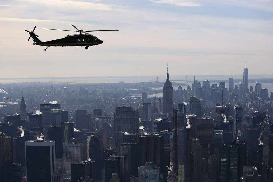 A Blackhawk helicopter flown by U.S. Customs and Border Protection, flies over Manhattan in route to MetLife Stadium. Photo: John Moore, Getty Images
