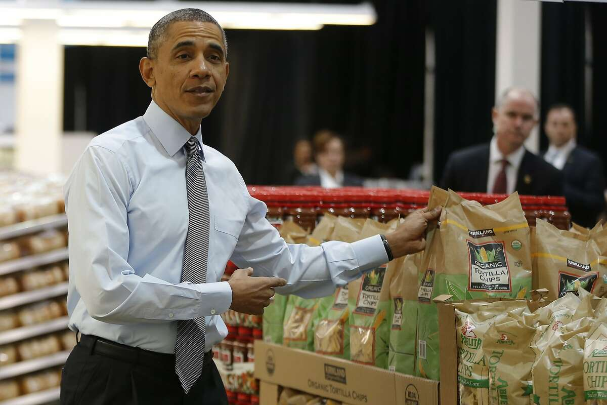 President Obama holds up a bag of tortilla chips Wednesday during a visit at a Costco store in Lanham, Md. (AP Photo/Charles Dharapak)