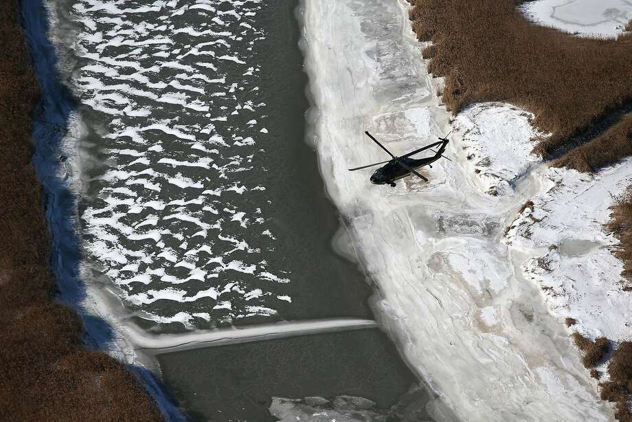 A Customs and Border Protection Blackhawk helicopter patrols near MetLife Stadium ahead of Super Bowl XLVIII. Photo: John Moore, Getty Images