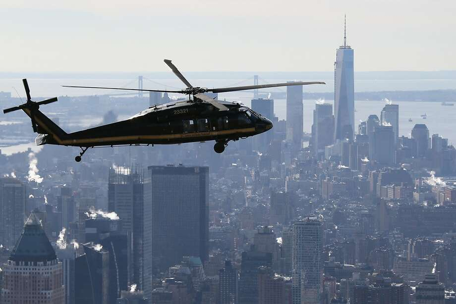 A Customs and Border Protection Blackhawk flies over Manhattan in route to MetLife Stadium. Photo: John Moore, Getty Images