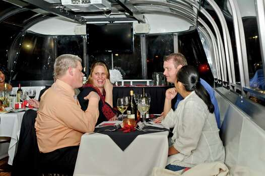 For Valentine's 2014, Landry's Seafood-Woodlands is offering a 90-minute dinner cruise on Woodlands Waterway. Its five courses for $325 per couple. Cruises depart 5:30 p.m. and 7:30 p.m. Dinner by Landry's Seafood.  Sample meal: appetizer trio of stuffed shrimp, fried calamari and crab cocktail, lobster bisque, Caesar salad, Snapper Amore and chocolate-covered strawberries and champagne. Dinner includes one complimentary bottle of wine per couple. Photo: Courtesy Photo / ONLINE_YES
