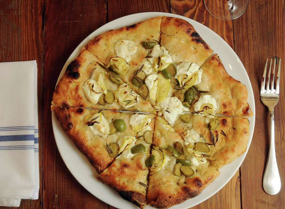 The pizza with Meyer lemon, olives, goat cheese and rosemary at Coltivare restaurant at 3320 White Oak Wednesday Jan 15 2014.(Dave Rossman photo) Photo: Dave Rossman, Freelance / © 2013 Dave Rossman