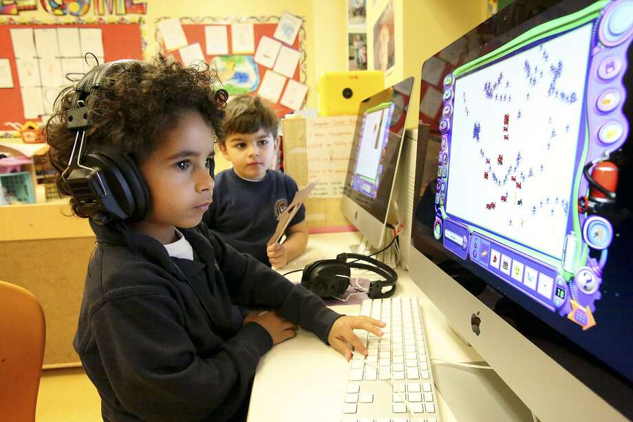 New Jersey preschoolers Jeremy Jimenez (left) and Gabriel Gonzalez, both 4, live in a state that has increased children's access to early education. Photo: Suzanne Dechillo, New York Times