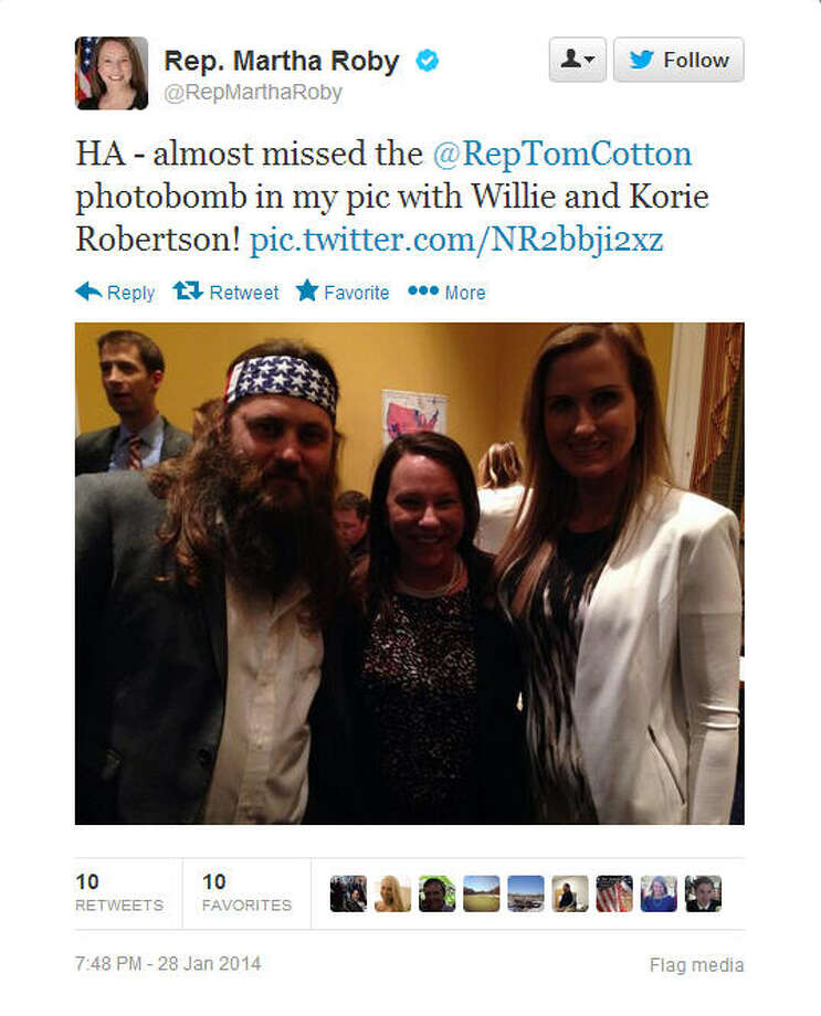 Rep. Martha Roby, R-Ala., gleefully points out Rep. Tom Cotton's, R-Ark., unintentional photobomb.Source: Twitter