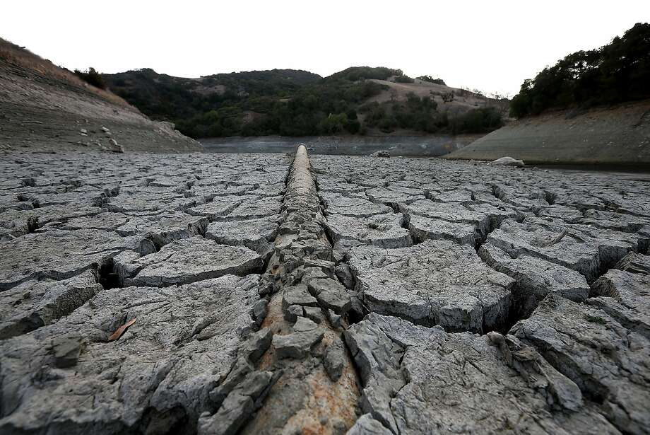 A pipe emerges from the bottom of the dry Almaden Reservoir on Tuesday. Photo: Justin Sullivan, Getty Images