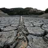A pipe emerges from dried and cracked earth that used to be the bottom of the Almaden Reservoir  on January 28, 2014 in San Jose, California. Now in its third straight year of drought conditions, California is experiencing its driest year on record, dating back 119 years, and reservoirs throughout the state have low water levels. Santa Clara County reservoirs are at 3 percent of capacity or lower.