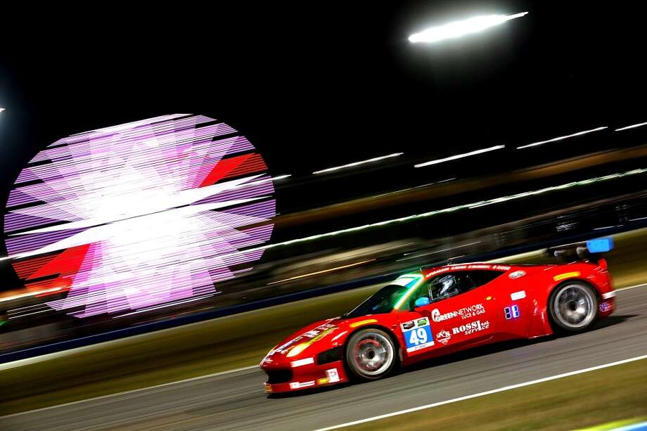 The #49 Spirit of Race Ferrarri 458 Italia driven by Piergiuseppe Peerazzini, Gialuca Roda, Paolo Ruberti and David Rigon during night practice for the Rolex 24 at Daytona International Speedway in Daytona Beach, Florida. Photo: Jerry Markland, Getty Images