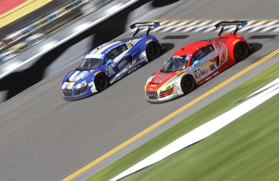The #45 Flying Lizard Motorsports Audi R8 LMS races with the #46 Fall-Line Motorsports Audi L8 LMS during practice for the Rolex 24 at Daytona International Speedway in Daytona Beach, Florida. Photo: Jerry Markland, Getty Images