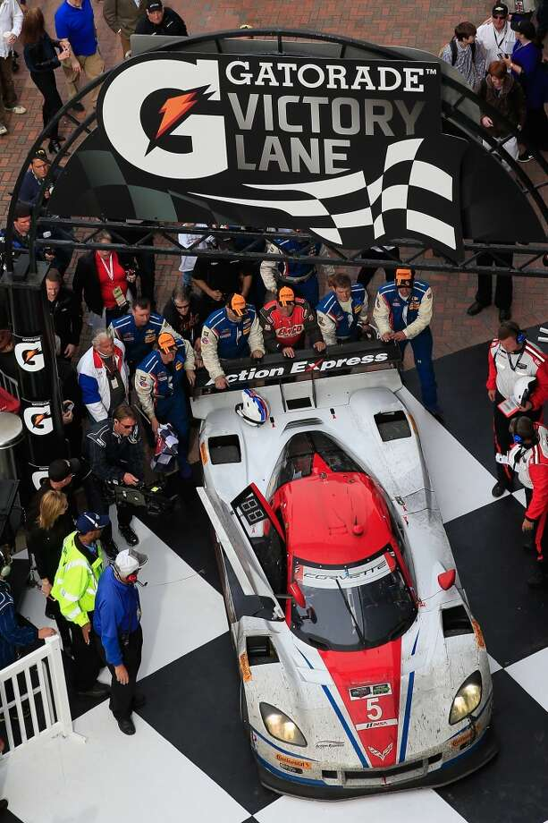 The #5 Action Express Racing Corvette DP driven by Joao Barbosa, Christian Fittipaldi, Sebastien Bourdais and Burt Frisselle is pushed in to victory lane following their victory in the Rolex 24 at Daytona International Speedway in Daytona Beach, Florida. Photo: Chris Trotman, Getty Images