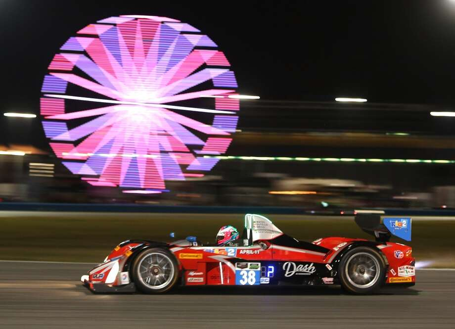 The #38 Performance Tech Motorsports ORECA FLM09 driven by Ryan Booth, Raphael Matos, Tomi Drissi, Gabriel Casagrande and Julio Campos during night practice for the Rolex 24 at Daytona International Speedway in Daytona Beach, Florida. Photo: Jerry Markland, Getty Images