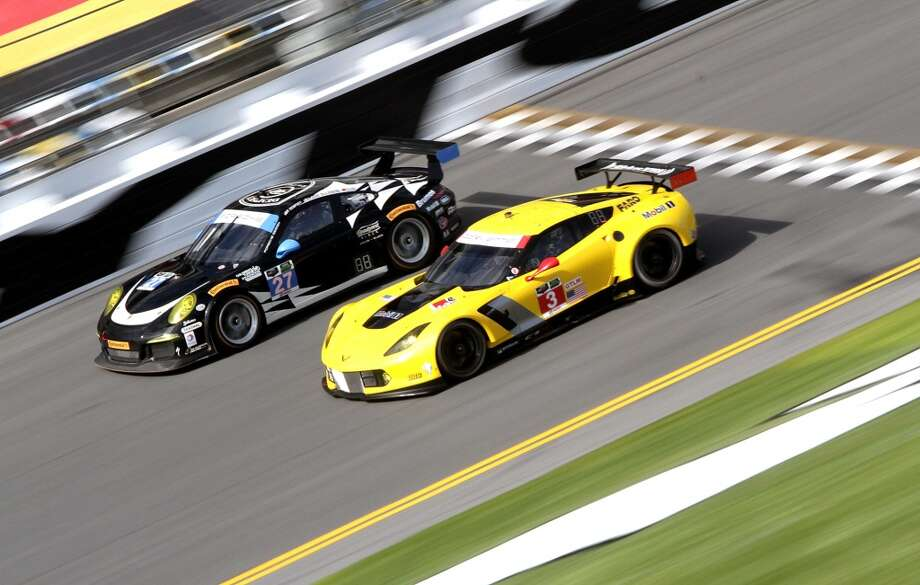 The #3 Corvette Racing Chevrolet Corvett C7.R races with the #27Dempsey Racing Porsche 911 GT America during practice for the Rolex 24 at Daytona International Speedway in Daytona Beach, Florida. Photo: Jerry Markland, Getty Images