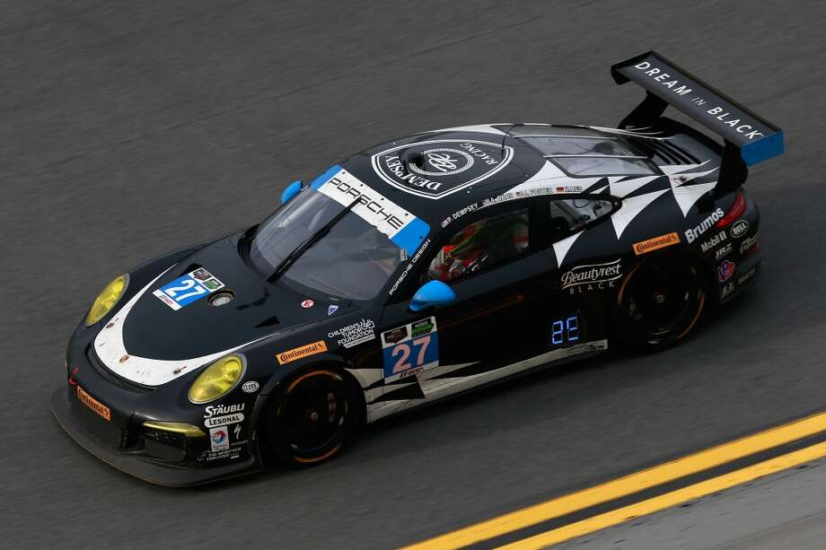 The #27 Dempsey Racing Porsche 911 GT driven by Patrick Dempsey, Joe Foster, Andrew Davis and Marc Lieb races during the Rolex 24 at Daytona International Speedway in Daytona Beach, Florida. Photo: Chris Trotman, Getty Images