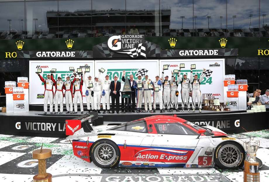 Overall Class winners, GT Daytona (L), GT Le Mans, Prototype and Prototype Challenge (R) celebrate victory on the podium at the ROLEX 24 at Daytona International Speedway in Daytona Beach, Florida. Photo: Jerry Markland, Getty Images