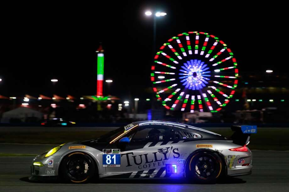 The #81 GB Autosport Porsche 911 GT America driven by Damien Faulkner, Patrick Huisman and Bob Faieta drives during the Rolex 24 at Daytona International Speedway in Daytona Beach, Florida. Photo: Chris Trotman, Getty Images