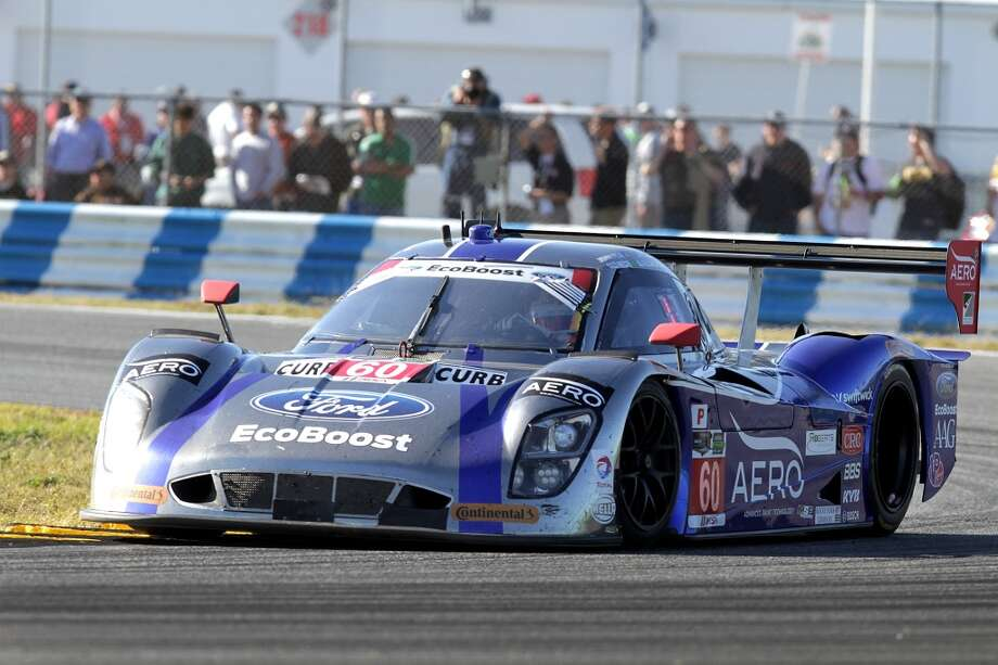 The #60 Micahel Shank Racing Curb/Agajanian driven by John Pew, Oswaldo Negri, AJ Allmendinger and Justin Wilson races during the ROLEX 24 at Daytona International Speedway in Daytona Beach, Florida. Photo: Jerry Markland, Getty Images
