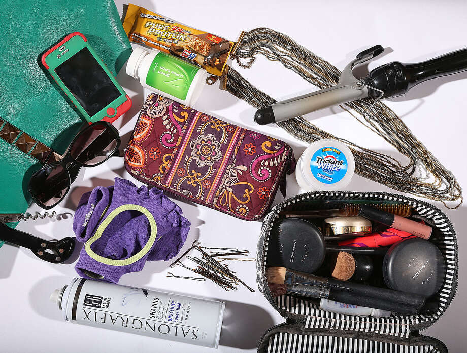 "Hair spray and curling iron are must-haves for Shelly Miles. Ditto for the wine opener. (""You never know when you will need it."") Bobby pins, yoga toe socks and extra jewelry go in the tote too. Photo: Photos By Jerry Lara / San Antonio Express-News / © 2013 San Antonio Express-News"