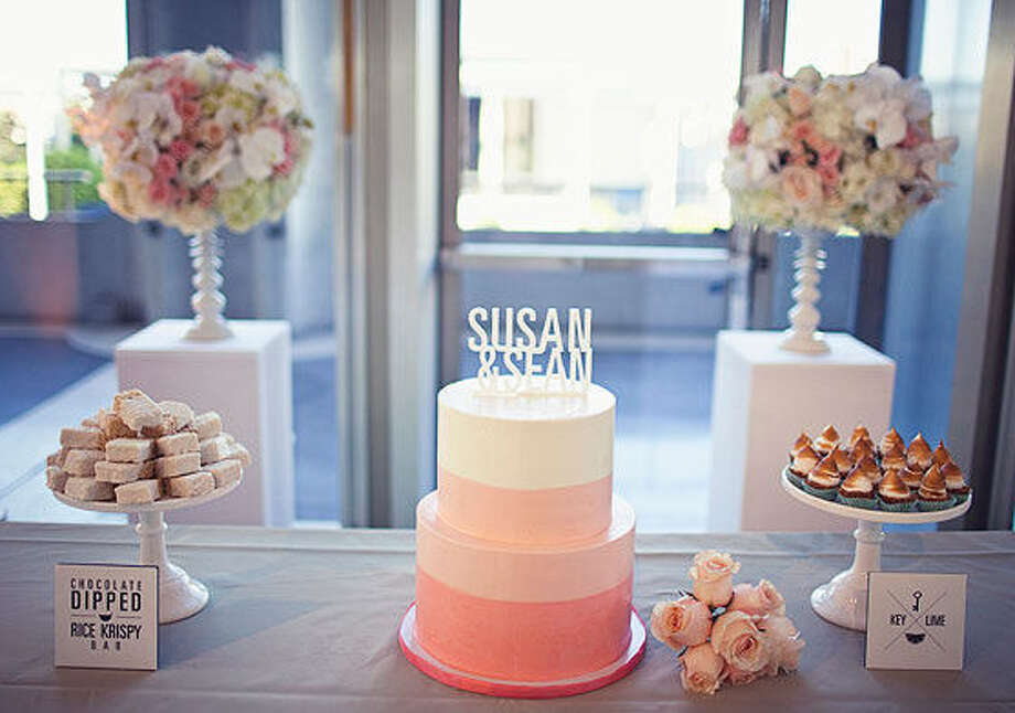 In 2014, some couples are choosing a dessert table with a smaller, simpler wedding cake with other small desserts instead of a large, traditional wedding cake. Photo: Courtesy Photo / courtesy of Project Wedding and